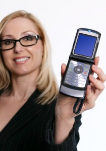 famale holding an open flip phone